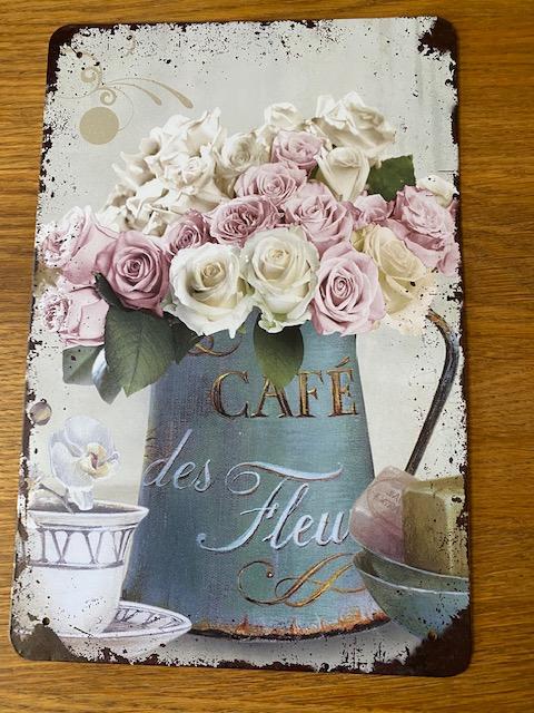 Peltitaulu, ruusut kannussa